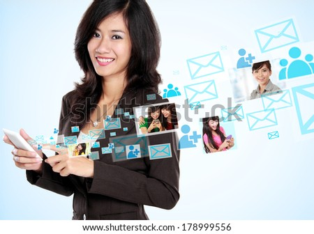 Happy businesswoman receiving and sending email. social media hightech concept - stock photo