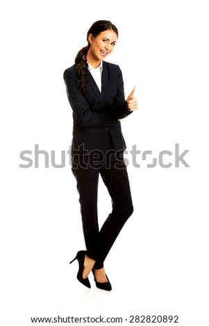 Happy businesswoman showing thumb up. - stock photo