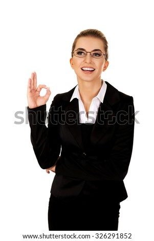 Happy businesswoman shows sign perfect. - stock photo
