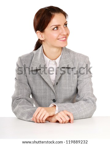 Happy businesswoman sitting on the desk. Isolated on white background. - stock photo