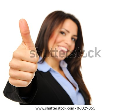 Happy businesswoman suit with thumb up, focus on hand - stock photo
