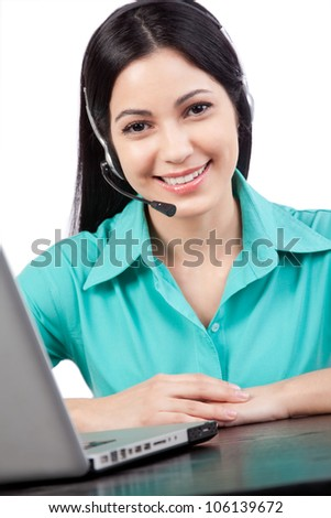 Happy businesswoman wearing a headset at work isolated on white background. - stock photo