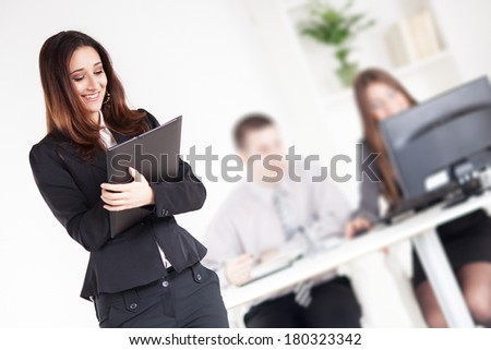 Happy Businesswoman with documents in the office. Selective Focus.