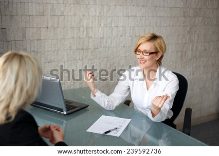 Happy businesswoman with ideas on meeting - stock photo