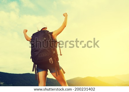 happy camper conquer the mountain tops and enjoys success - stock photo