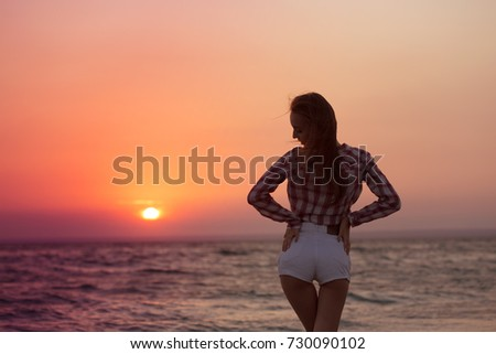 Happy carefree woman on the beach enjoying summer