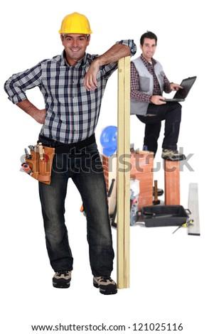 Happy carpenter and builder - stock photo