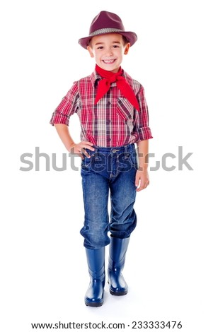 Happy casual agriculturist boy in blue jeans, boots and hat