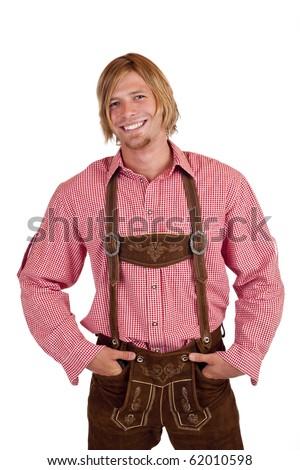 Happy casual Bavarian man with oktoberfest leather trousers (lederhose) . Isolated on white background. - stock photo