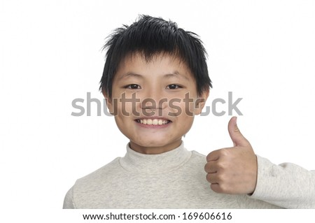 Happy casual little boy showing thumb up