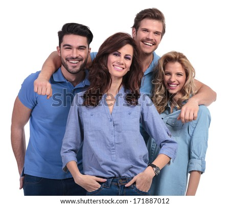 happy casual man embracing his laughing friends on white background