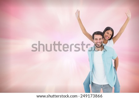 Happy casual man giving pretty girlfriend piggy back against digitally generated pink girly design - stock photo