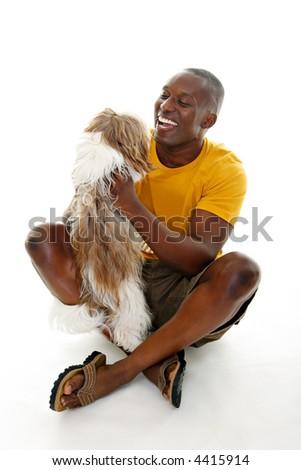 Happy casual man holding a happy dog. - stock photo