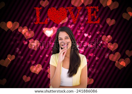 Happy casual woman thinking with hand on chin against digitally generated girly heart design - stock photo