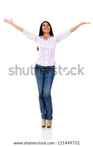 Happy casual woman with arms up - isolated over a white background - stock photo