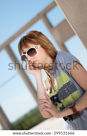 Happy casual young girl posing with sunglasses - stock photo