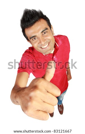 Happy casual young man showing thumb up isolated on white background - stock photo