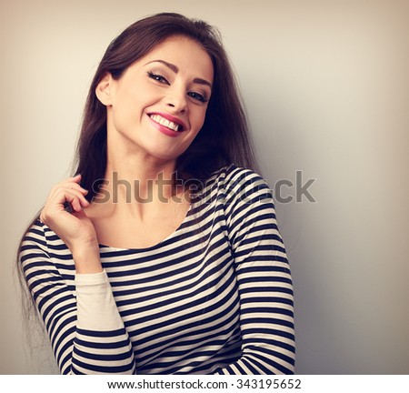 Happy casual young woman with wild toothy smiling looking. Vintage closeup portrait - stock photo