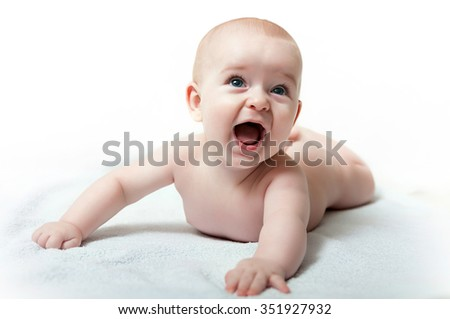 happy caucasian baby boy with his mouth open on white background