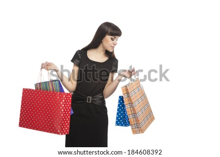Happy Caucasian Brunette Woman With Shopping Packs. Horizontal Image. Isolated Over White Background