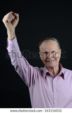 Happy Caucasian businessman  on black background