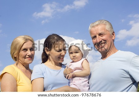 Happy Caucasian family of four standing in the street
