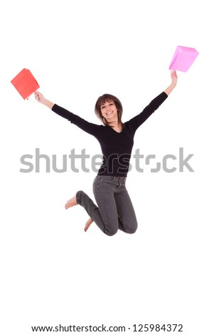 Happy caucasian woman jumping with shopping bags isolated over a white background
