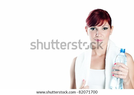 Happy caucasian young woman with a towel and a bottle of water, isolated on white, copyspace - stock photo