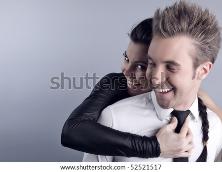 Happy charming couple embrace each other. Beautiful and happy. Studio photo with copyspace.