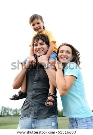 Happy cheerful family posing on nature. Three person