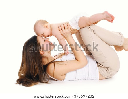 Happy cheerful mother playing with baby on a white background - stock photo