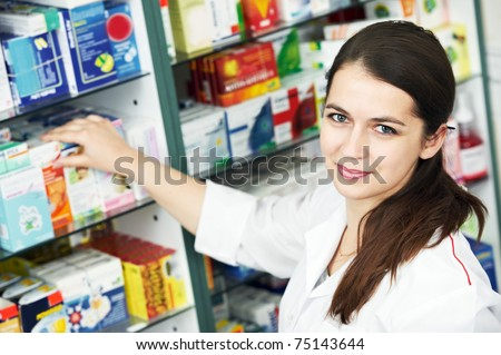 Happy cheerful pharmacist chemist woman standing in pharmacy drugstore - stock photo