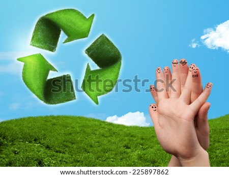 Happy cheerful smiley fingers looking at green leaf recycle sign - stock photo
