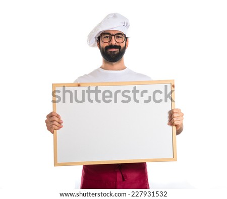 Happy chef holding empty placard