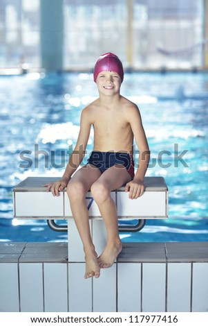 happy chid have fun on swimming pool - stock photo