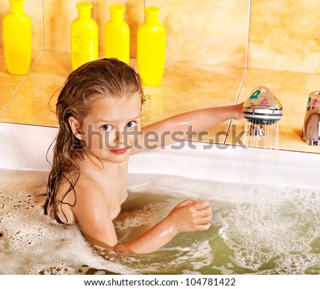 Happy child bathing in bubble bath . - stock photo