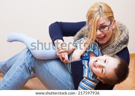 Happy child boy and woman having fun at home - stock photo