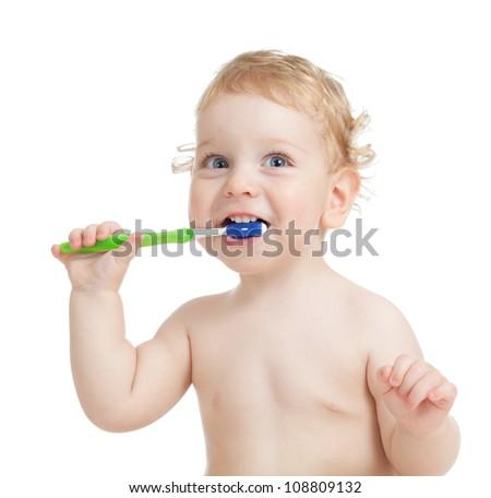 Happy child brushing teeth isolated on white - stock photo