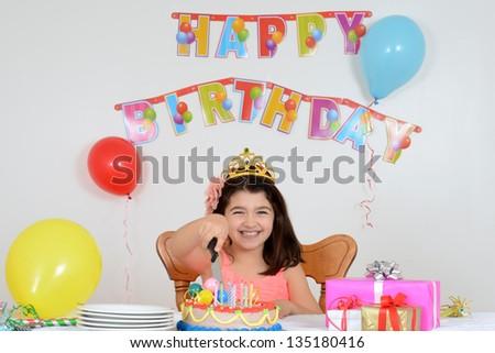 happy child cutting birthday cake - stock photo