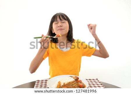 Happy child eating meal - stock photo