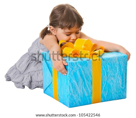 Happy child embraces large birthday gift isolated on white background