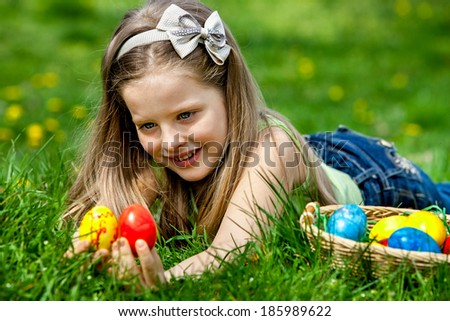 Happy child find easter egg outdoor. - stock photo