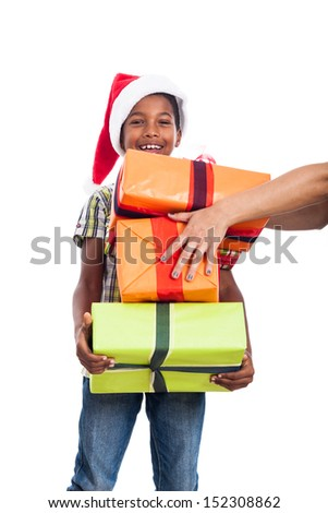 Happy child getting many Christmas presents, isolated on white background. - stock photo