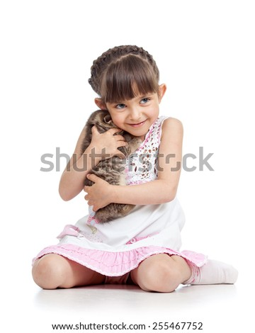 happy child girl hugging kitten isolated on white