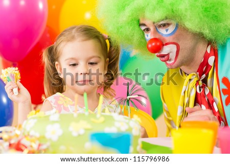 happy child girl with clown on birthday party - stock photo