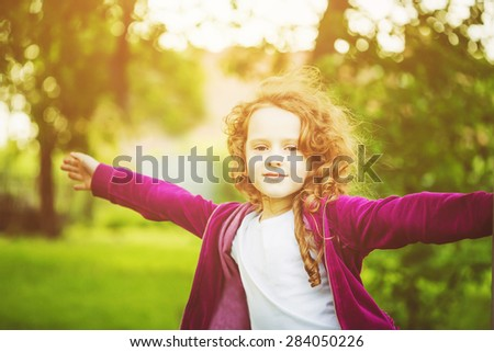 Happy child hand up, enjoying freedom at sunset. Freedom concept. Toning instagram filter. - stock photo