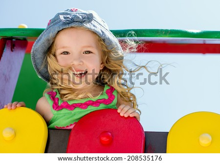 happy child having fun on the playground - stock photo