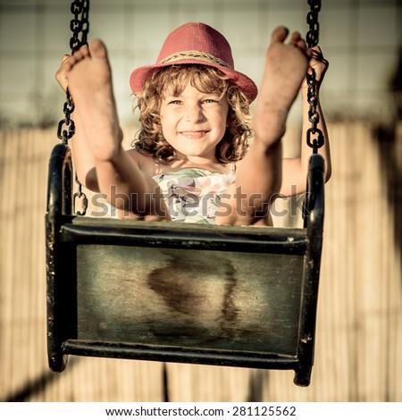Happy child having fun outdoors in summer park - stock photo
