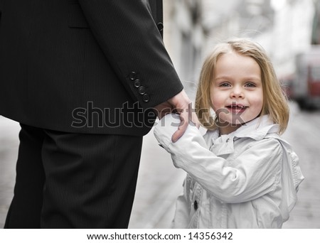 happy child holding father's hand - stock photo