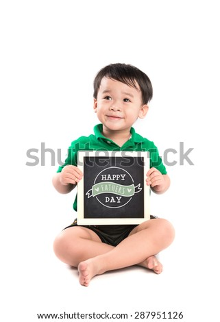 "Happy child holds up a drawing for his Dad; ""Happy Father Day""  - sign for family relationships or a happy fathers day greeting. - stock photo"